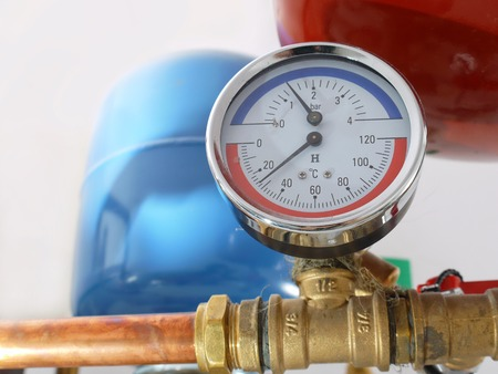 Temperature and pressure gauge mounted on boiler pipes photo