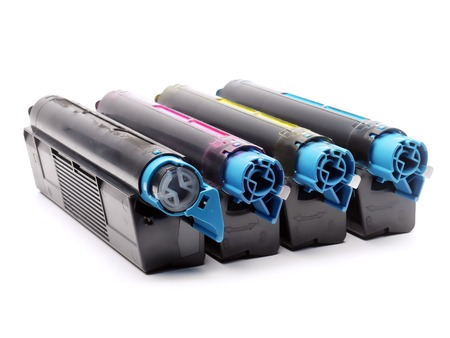 Four used laser printer toner cartridges of Cyan, Magenta, Yellow and black color shot over white background Stock Photo