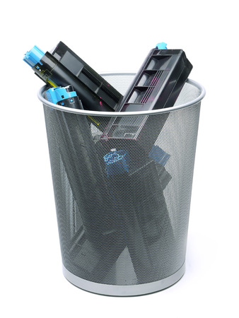 Used laser printer cartridges in metal trash bin over white