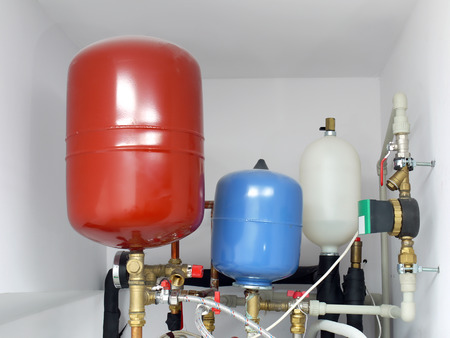Group of expansion tanks in house boiler room