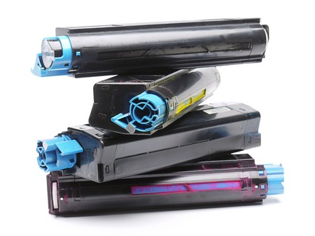Pile of four used laser printer toner cartridges of Cyan, Magenta, Yellow and black color shot over white background Standard-Bild
