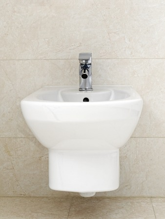 toilet seat: Wall mounted white ceramic bidet