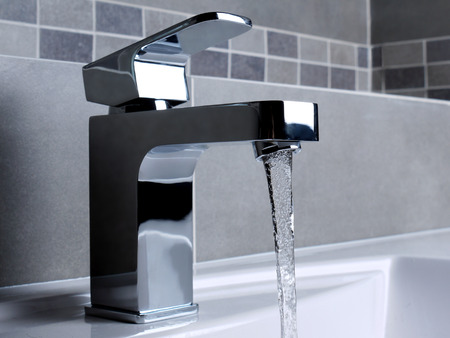 wash basin: Modern bathroom chrome faucet with running water