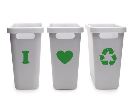 Three gray plastic disposal containers with green I Love Recycling pictogram over white background Stock Photo