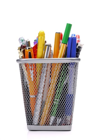 Metal mesh container full of writing tools shot over white background Stock Photo - 26123688