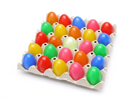 egg carton: Colorful easter eggs in paper box shot over white background