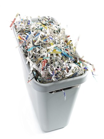 cuttings: Paper cuttings in gray plastic disposal bin - over white background Stock Photo