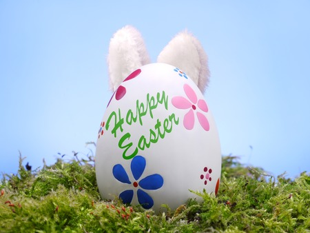 protrude: Easter egg in grass with bunny