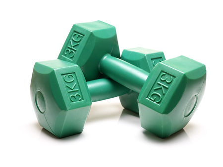 kg: Pair of green 3 kg dumbbels shot over white background Stock Photo