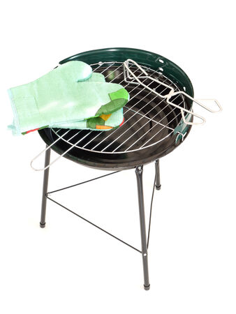 Barbecue grill with tongs and thin-insulated gloves shot on white 版權商用圖片