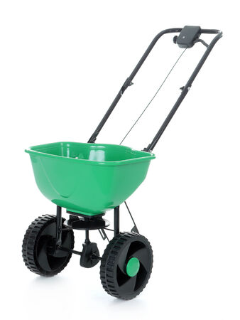 Manually operated seeder shot on white photo