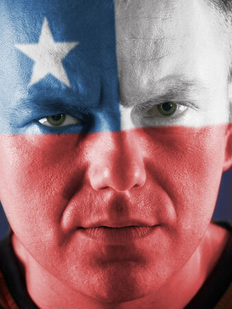chilean flag: Closeup of young Chilean supporter face painted with national flag colors Stock Photo