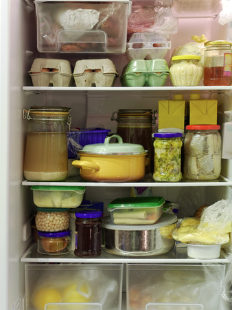 stocked: Refrigerator inside full of assorted food ingredients, fruit, vegetables, meat and dairy products