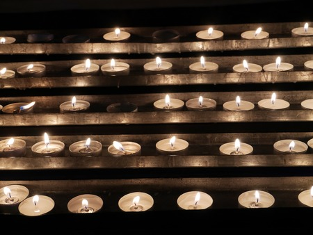 votive candle: Rows of lit votive candles Stock Photo