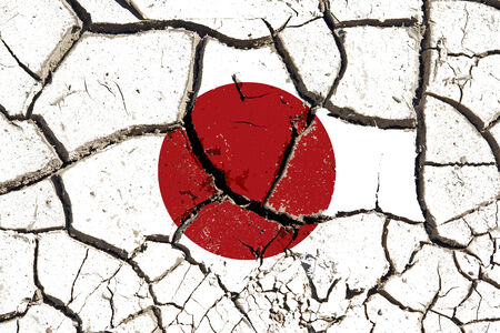 symbolize: Cracked soil as Japan flag to symbolize the recent earthquake and calamity that struck this country