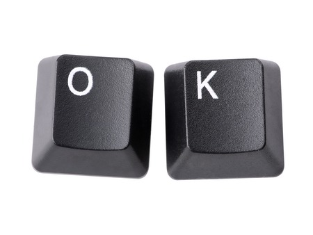 acronym: Two black keyboard keys forming OK acronym over white background