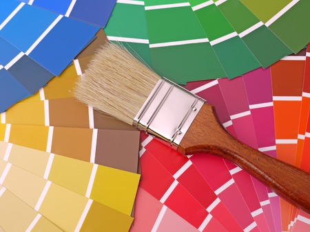 gamut: Paint brush on array of different paint color swatches