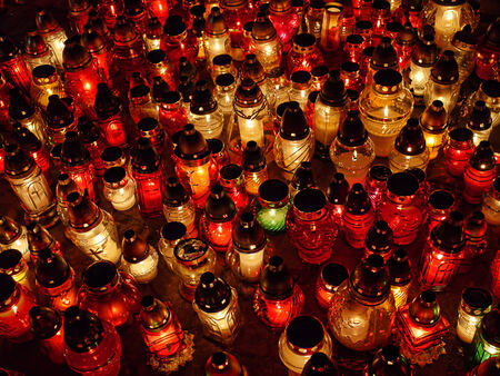votive candle: Bunch of glass votive candles lit in the dark