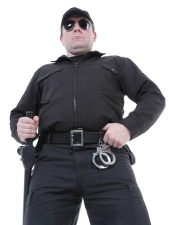Policeman wearing black uniform and glasses standing confidently  photo