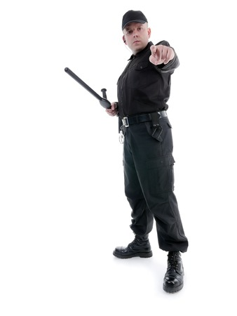 Policeman wearing black uniform pointing in ordering manner photo