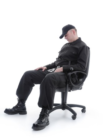 Security man sleeping on armchair shot on white Banque d'images