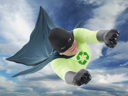 Eco friendly green superhero flying in the air  photo