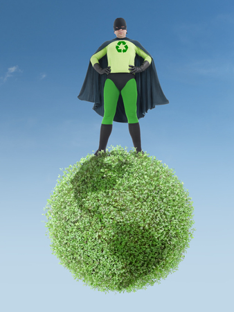 Eco superhero standing on green Earth planet - clean environment concept photo
