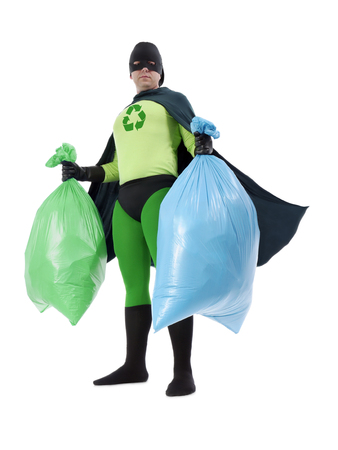 Eco superhero holding green and blue plastic bags full of domestic trash standing on white background - waste segregation concept photo