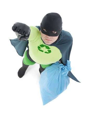 segregation: Eco superhero holding blue plastic bag full of domestic trash pointing his hand up standing on white background - waste segregation concept