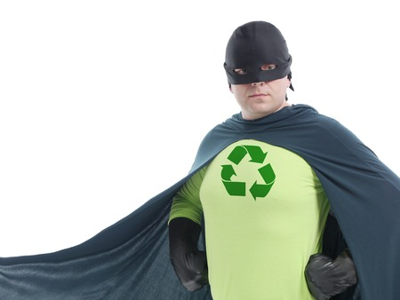 Eco superhero with green recycle arrow symbol on chest posing confidently over white background - recycle concept photo