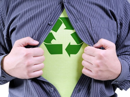 A man wearing shirt transforming into Eco superhero with green recycle arrow symbol underneath on chest - recycle concept photo