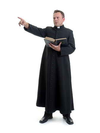 Catholic priest preaching holding open the Bible book shot on white Stock Photo