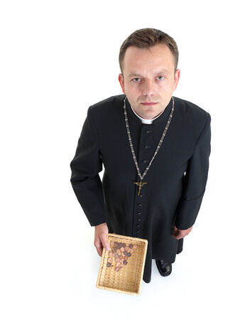 penny pinching: Catholic priest with collection plate