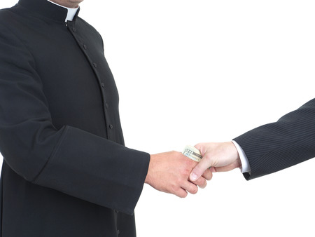 cupidity: Catholic priest receiving bribe from businessman