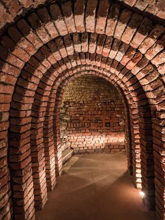 Old underground brickstone dungeon  photo