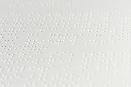 White paper with text in braille language