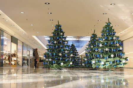 christmas display: Shopping mall interior decorated with christmas trees