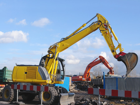 power shovel: Two diggers at work at the construction site