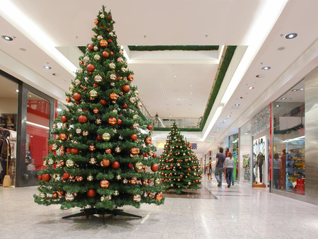 Shopping mall interior decorated with christmas trees