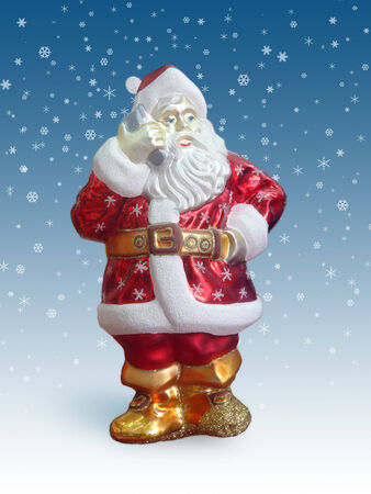 snow drift: Santa clause talking over mobile phone