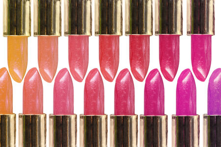 Overlaping rows of colorful lipsticks over white background photo