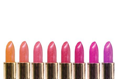 lip stick: Row of colorful lipsticks over white background