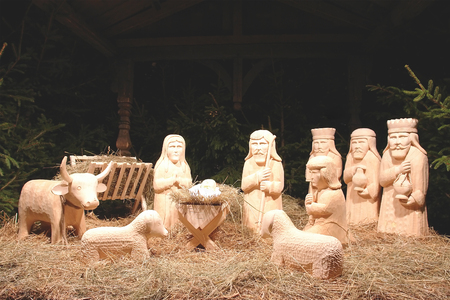 wisemen: Christmas crib figures curved from wood representing Holy Family, three wisemen and animals  Stock Photo