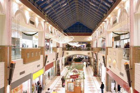 Inside multilevel shopping mall with christmas decorations