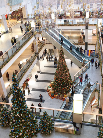 crowded space: Multilevel shopping mall interior decorated with christmas trees - aerial view