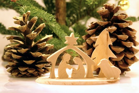 Christmas crib figures curved from wood representing Holy Family and animals photo