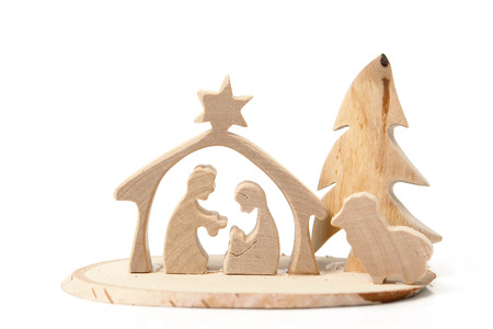 Christmas crib cut out from plywood over white  photo