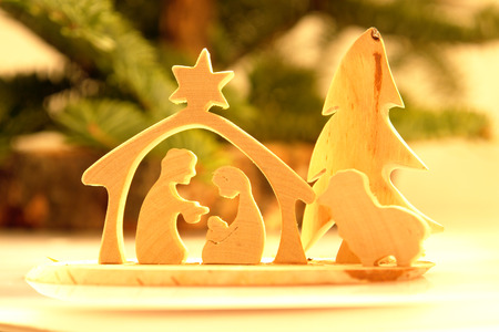 Wooden Christmas crib of Holy Family photo