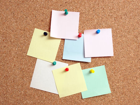 affix: Colorful blank paper notes affixed to the corkboard Stock Photo