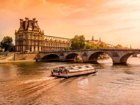 gleam:  Palais du Louvre by the Seine in beautiful orange Sun gleam, Paris, France